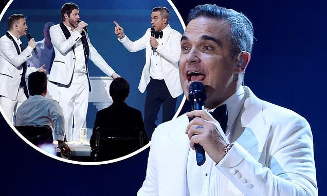 The X Factor final: Robbie Williams REUNITES with Take That on stage