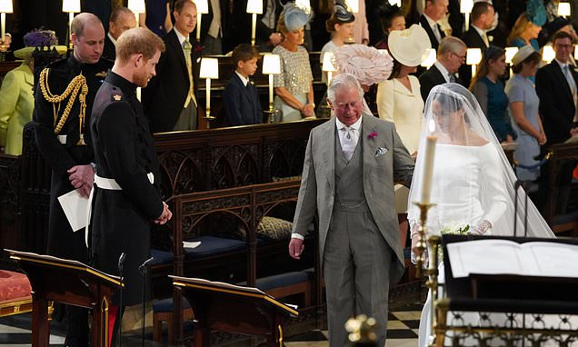 Prince Charles has a framed photo of him walking Meghan down the aisle
