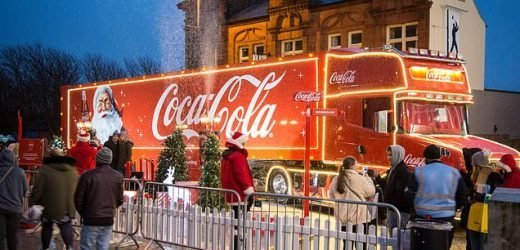 Campaigners try to stop Coca Cola's Christmas truck from visiting