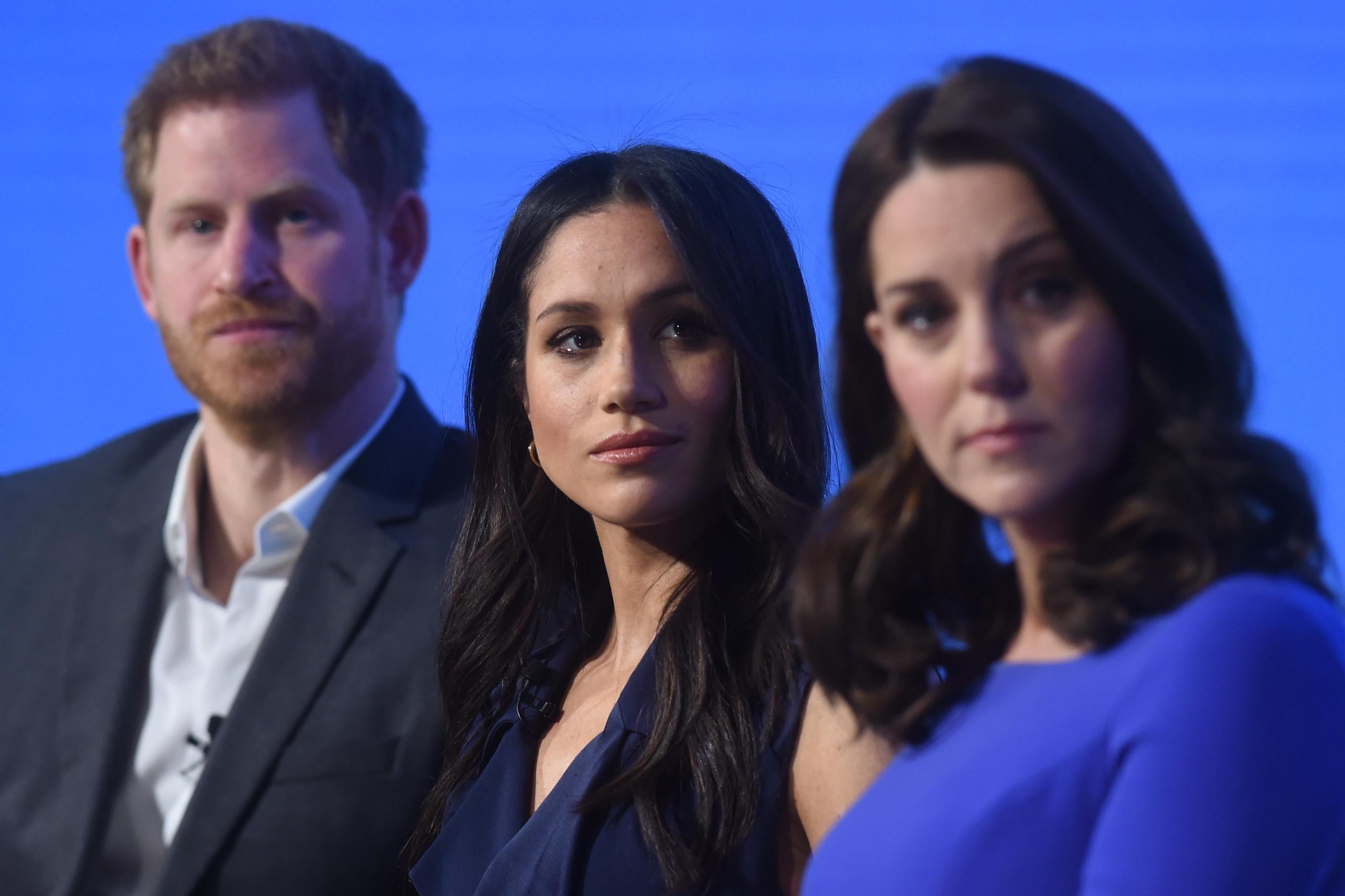 Meghan Markle and Kate Middleton's body language 'revealed rifts' when asked about rows in February… and Harry admitted they come 'thick and fast'