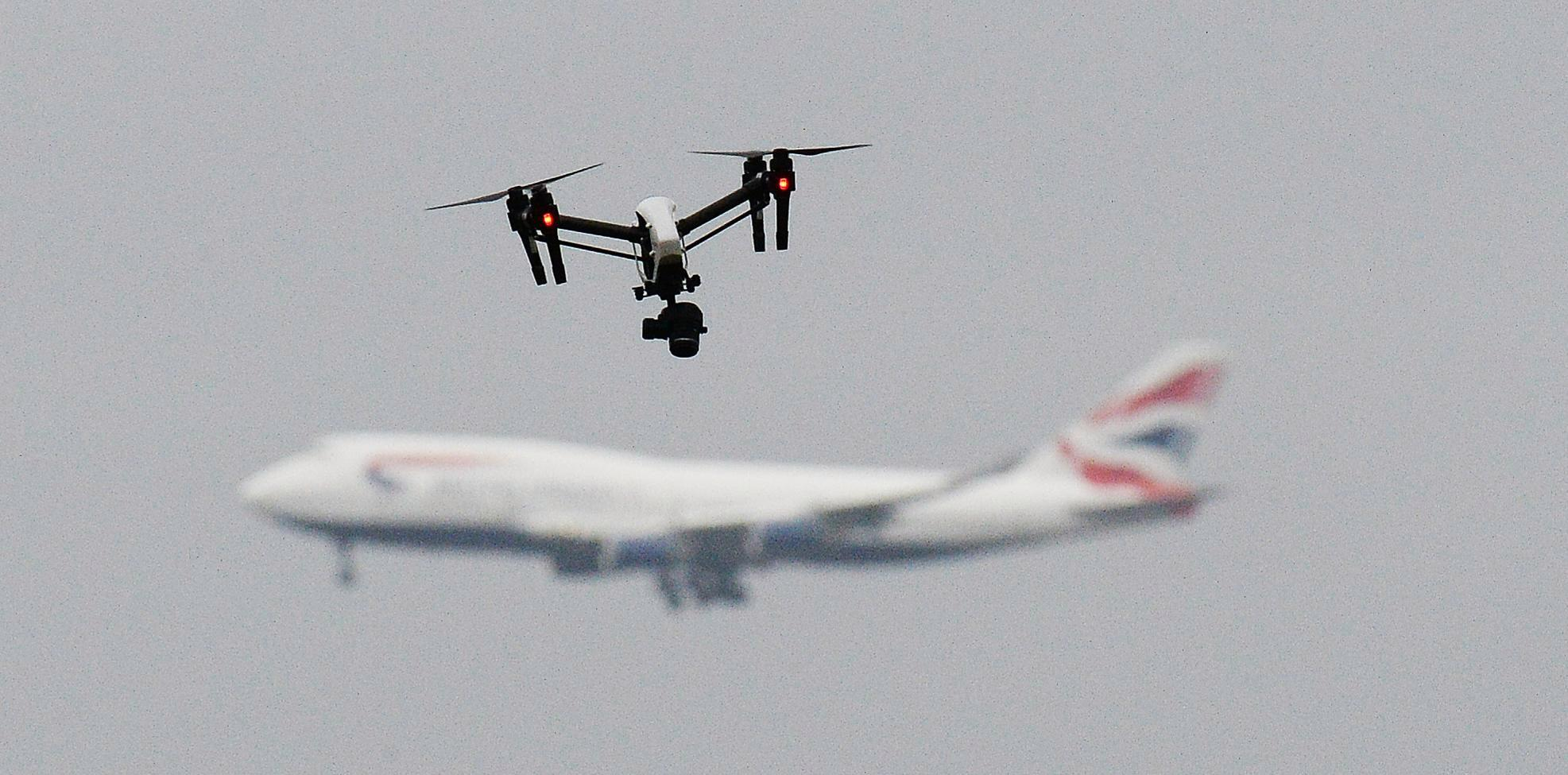 How dangerous are drones to aircraft and why do airports sometimes shut down?