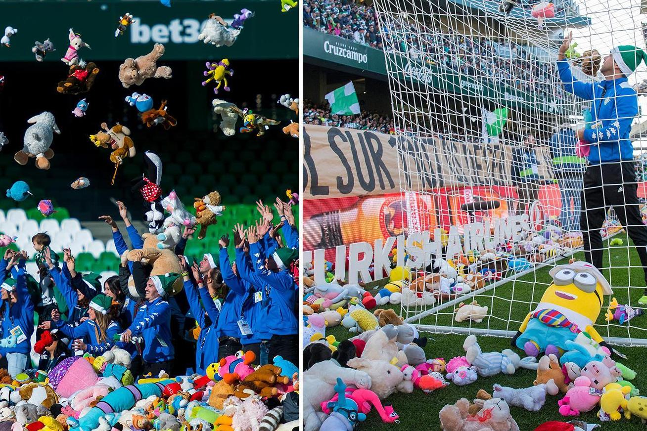 Real Betis fans throw hundreds of toys on the pitch for charity