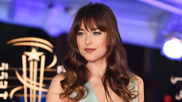 Dakota Johnson Stuns In Plunging Silver Gown At Film Festival – See Her Red Carpet Look