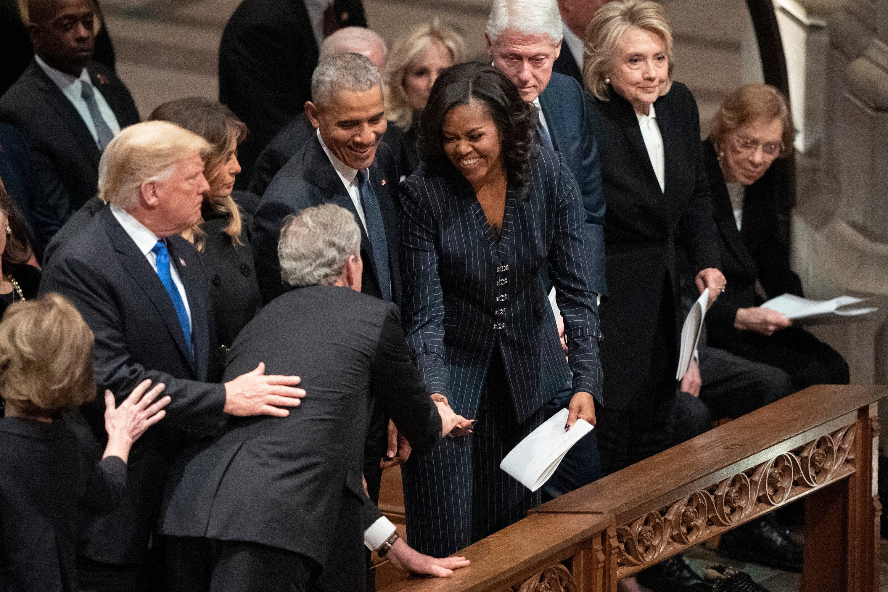 George W. Bush sneaks Michelle Obama a cough drop at his dad's funeral