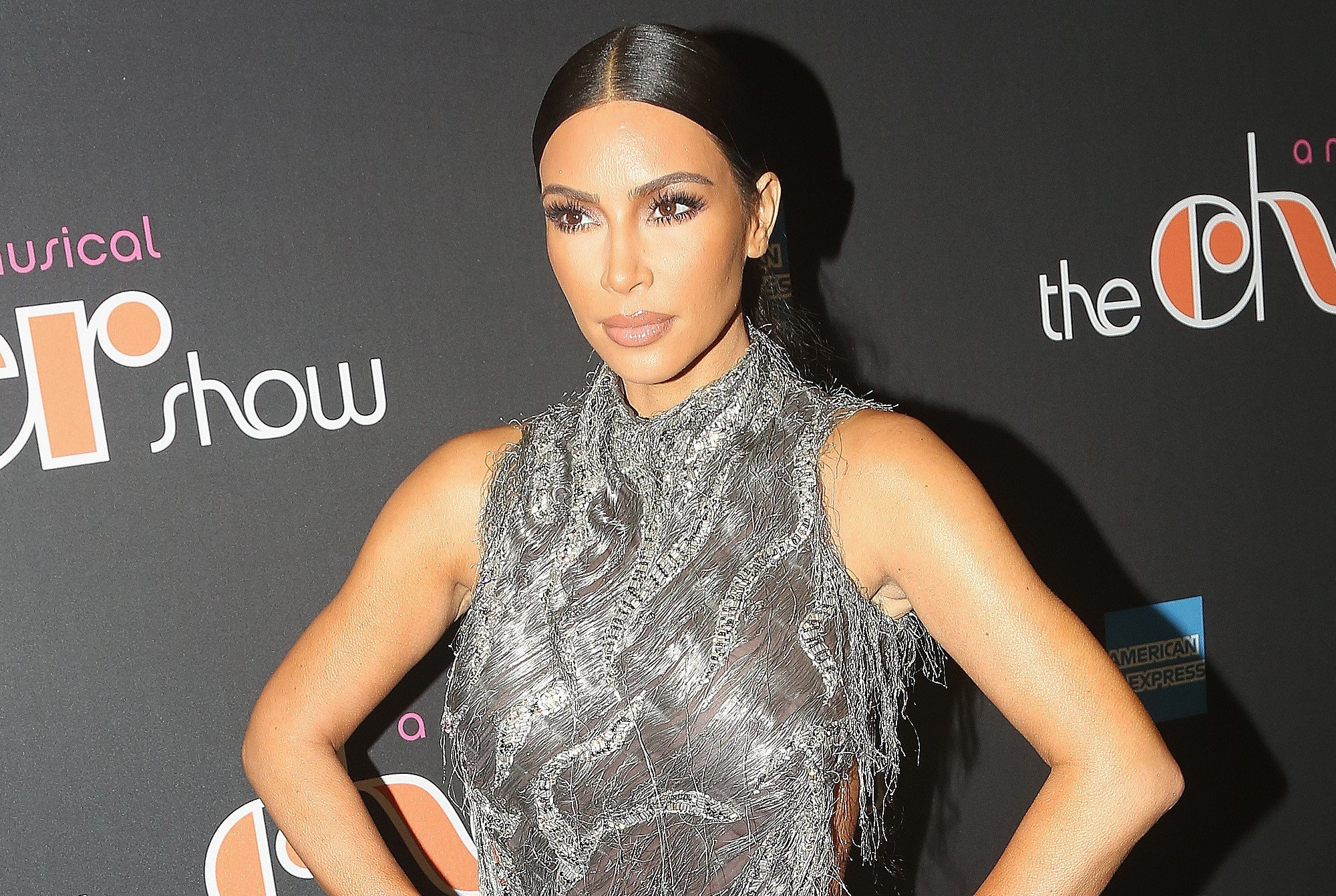 Kim Kardashian fixes her wardrobe malfunction with help from Cher
