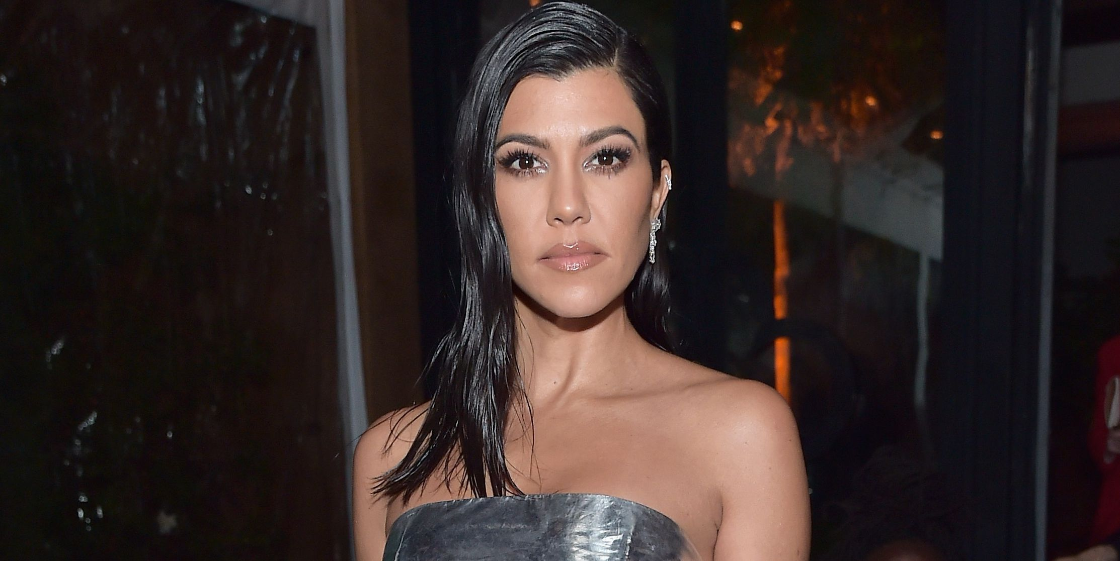 Kourtney Kardashian's Strapless Dress Is Giving Serious Tin Foil Vibes