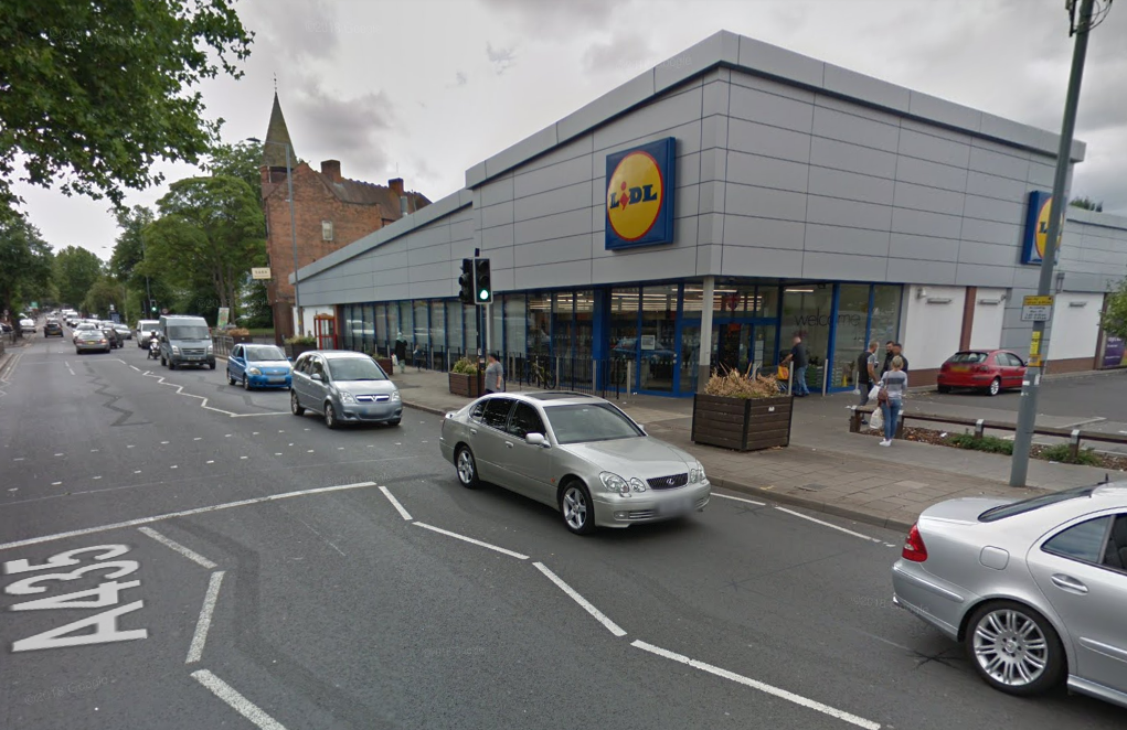 Man fighting for life after being PUSHED into oncoming traffic outside Lidl supermarket