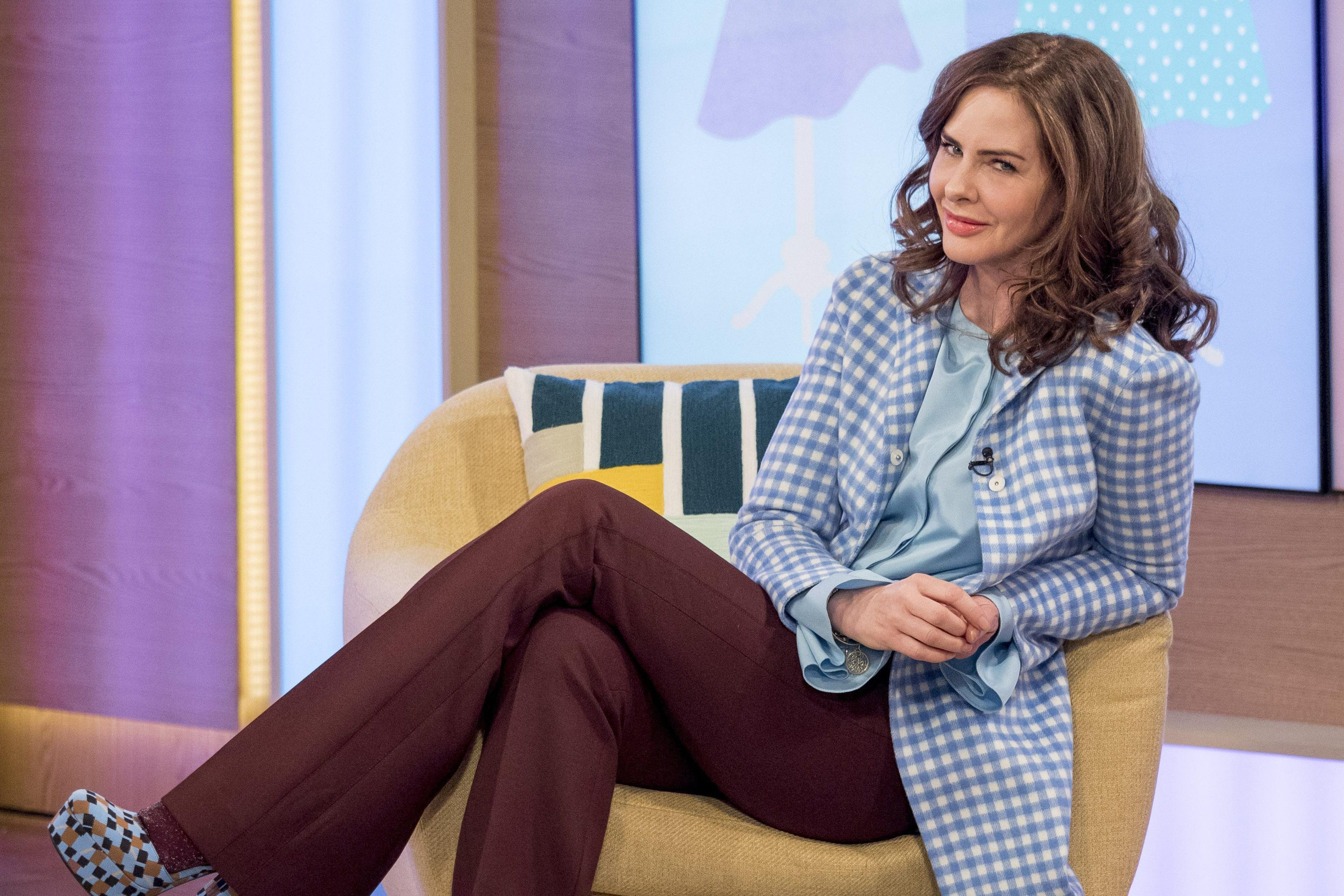 How old is Trinny Woodall, what shows did she present with Susannah Constantine and is the fashion expert dating Charles Saatchi?