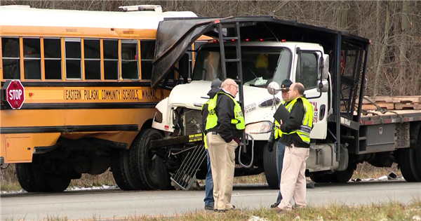 Teen killed after truck crashes into school bus on field trip in Indiana
