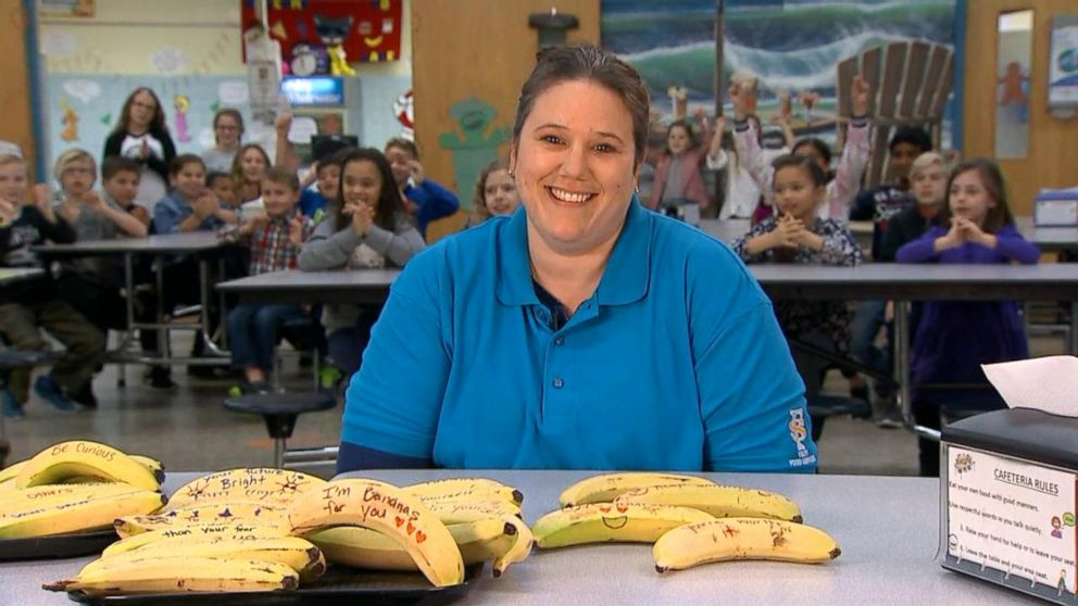 Cafeteria worker pens encouraging messages on bananas