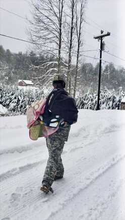 National Guard soldier carries stranded baby through snow after historic North Carolina storm