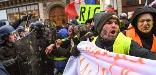Clashes and 148 arrests – but French protests wane after Macron concessions