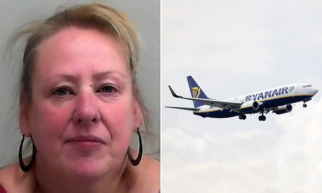 Drunk woman who forced plane to turn around is jailed for a year