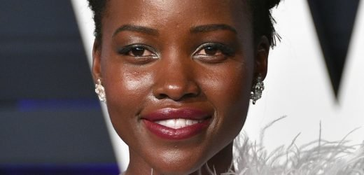Lupita Nyong'o Wore A MASSIVE Feathered Dress To The Oscars After Party