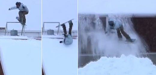 Moment snowboarder loses control as he jumps off roof in Finland