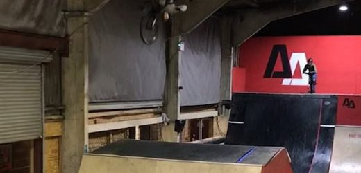 BMX rider lands face first after clipping the ceiling