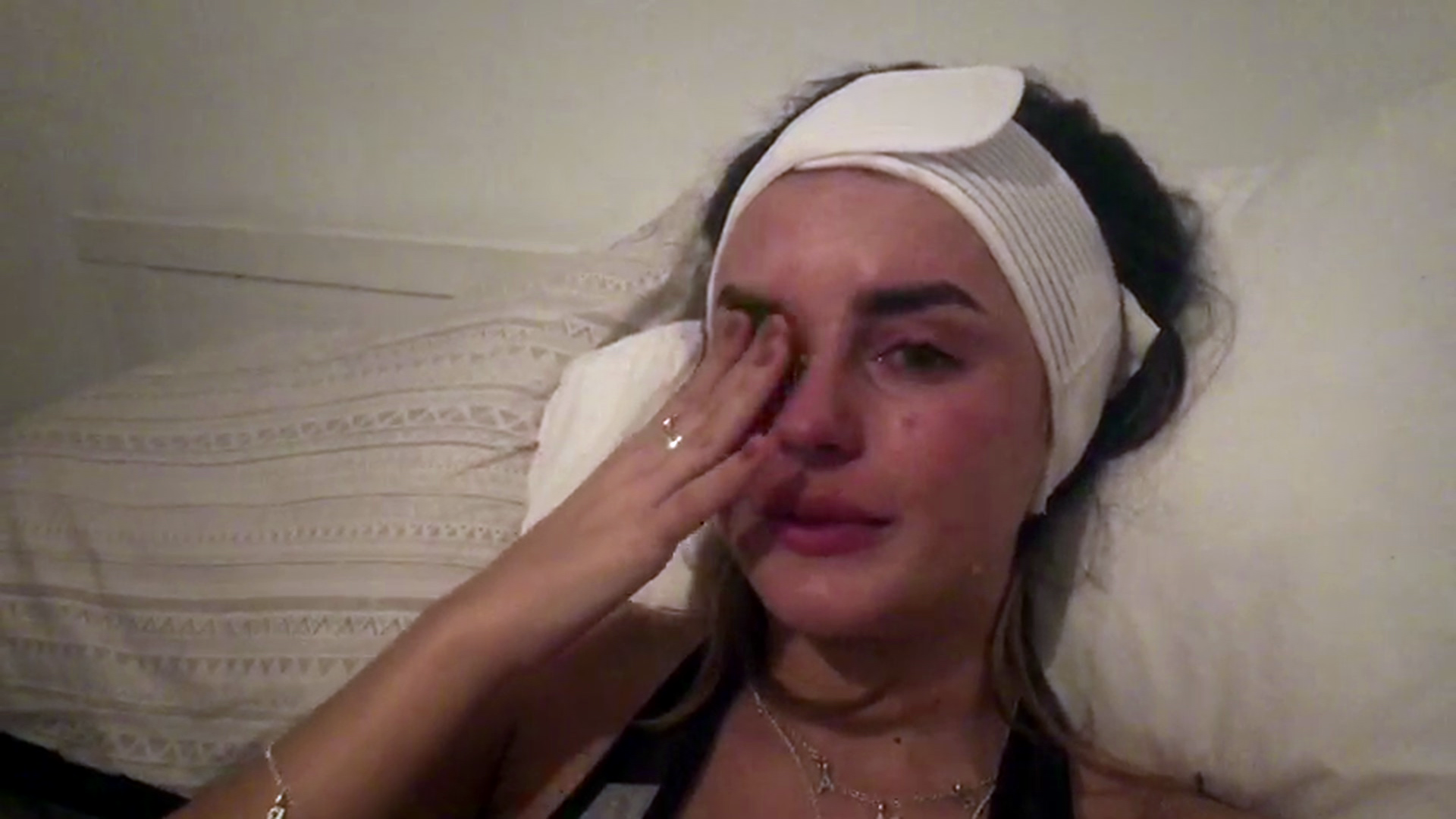 Amber Davies cries as she has her ears pinned back in surgery after years of insecurity
