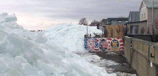 'Ice tsunami' spawned by windstorm spurs evacuations along Lake Erie, as thousands without power across East