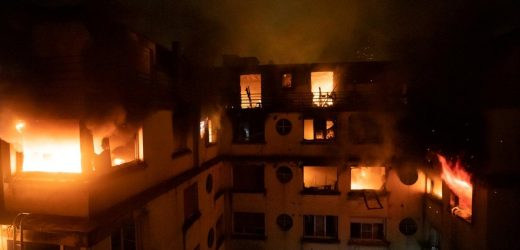 Fire kills eight in Paris apartment block, woman detained