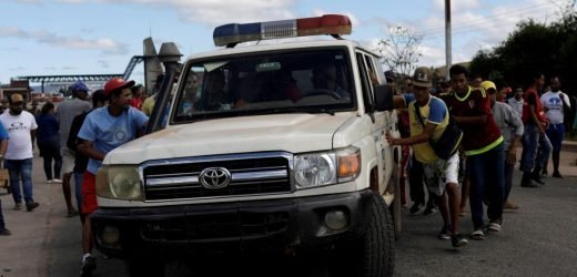 As tensions over aid rise, Venezuelan troops fire on villagers, kill two