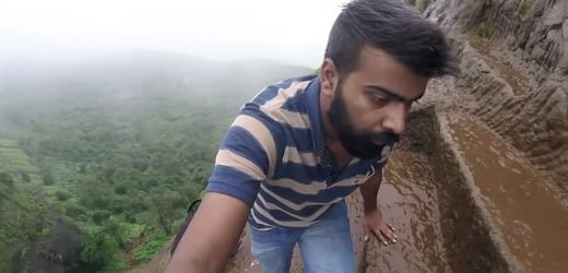 Friends climb 2,300ft staircase in the rain with no safety equipment