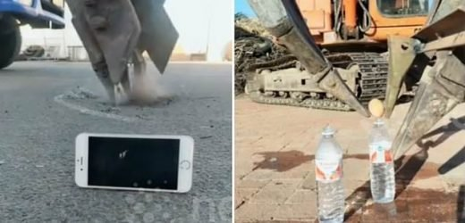 Digger driver uses excavator to turn on an iPhone and pick up and egg