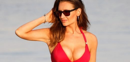 Ex-Corrie star Catherine Tyldesley smoulders in skimpy red bikini while on Dubai family holiday