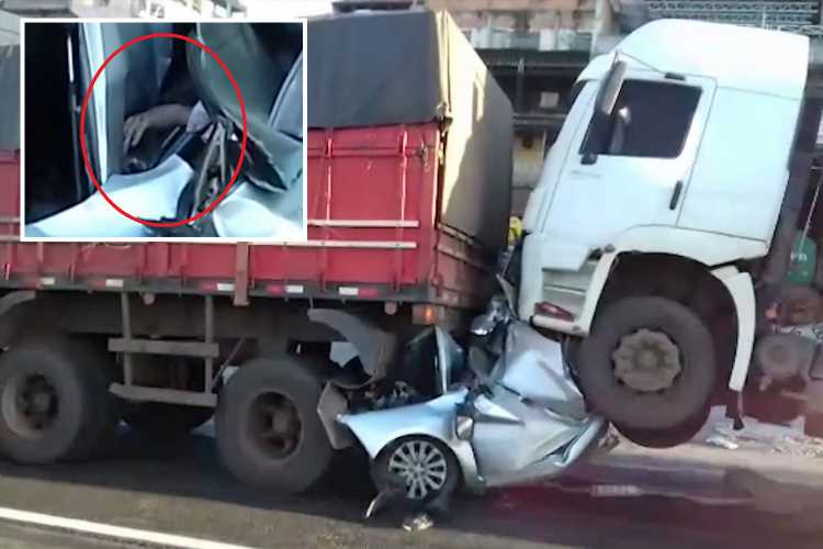 Eye-witnesses find motorist alive and talking wedged inside the footwell of his mangled car after horror crash with two lorries in Brazil