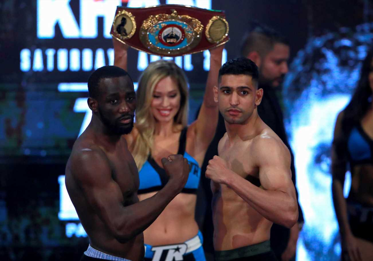 What is Amir Khan's boxing record, how many times has he been world champion and when was he at the Olympics?