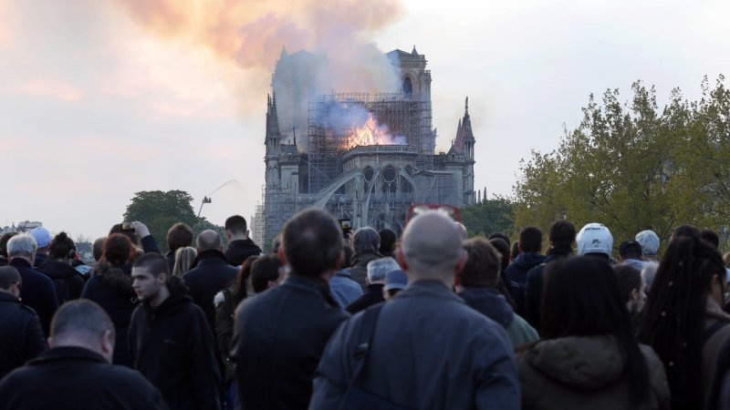 As history went up in flames, the sound of song came from Paris' streets