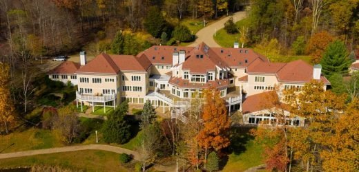 50 Cent was reportedly spending $70,000 a month on his 52-room Connecticut home. We asked 3 real-estate agents to break down the 'invisible' costs of owning a mansion.