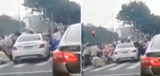 Horrifying moment car waiting at a red light ploughs into pedestrians