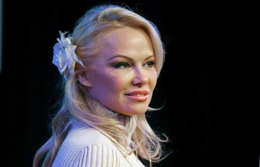 Pamela Anderson poses on first Vogue cover