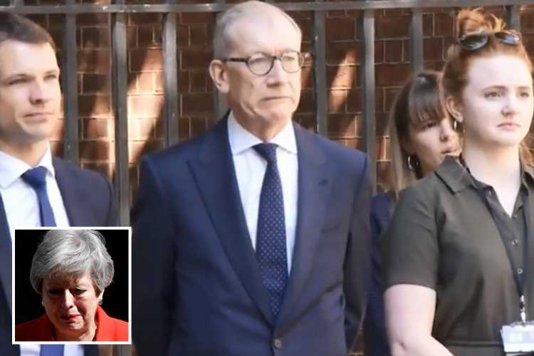 Theresa May's husband Philip grimaces as he watches the PM sob at end of resignation speech