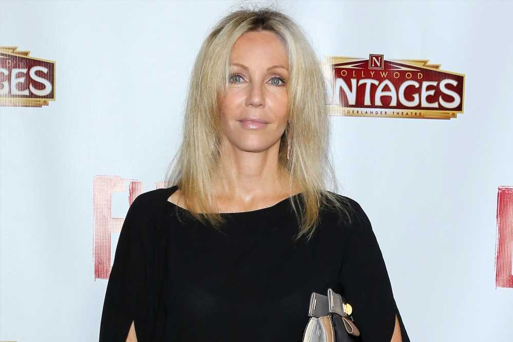 Heather Locklear Is Back in Rehab, Source Says: 'This Has Been Tearing Up Her Family'