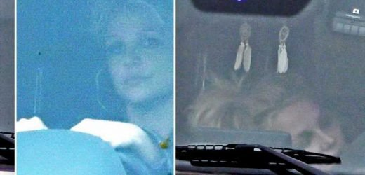 Britney Spears looks dazed behind the wheel after fears she was being 'held against her will'