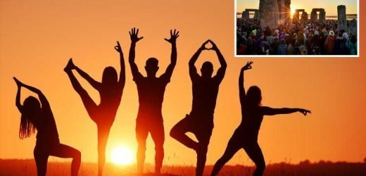 Yogis enjoy early morning workout as thousands gather to celebrate Summer Solstice at Stonehenge