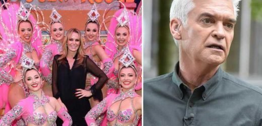 Amanda Holden poses with scantily clad dancers at the Moulin Rouge in Paris after blasting Phillip Schofield over This Morning job