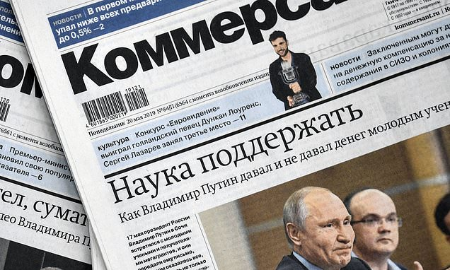 Russian journalist is charged with 'controlling minds'