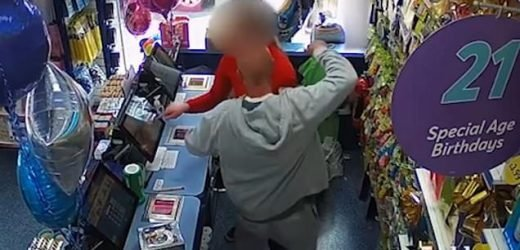 Terrifying moment robber holds pair of scissors to neck of shop worker