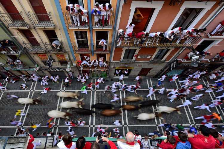 1 gored, multiple injured in race with bulls at Pamplona festival