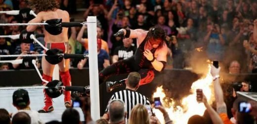 WATCH: Kane goes through flaming table at Extreme Rules 2014!