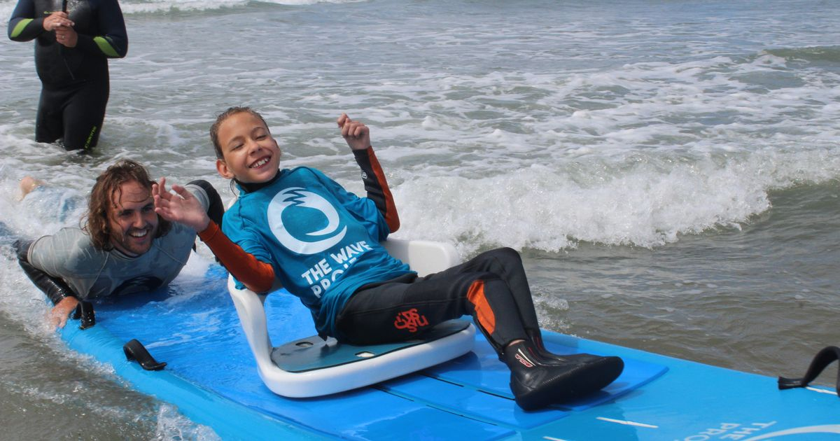 Girl with cerebral palsy thanks Sunday Mirror as she enjoys first surf lesson