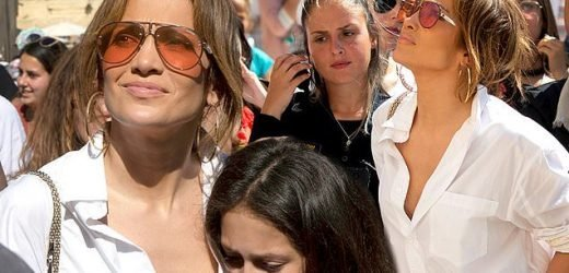 Jennifer Lopez goes unbuttoned in a white blouse at the Western Wall