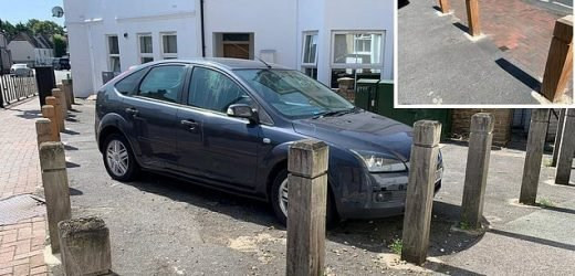 Car is stuck in a parking space for two weeks after bollards installed