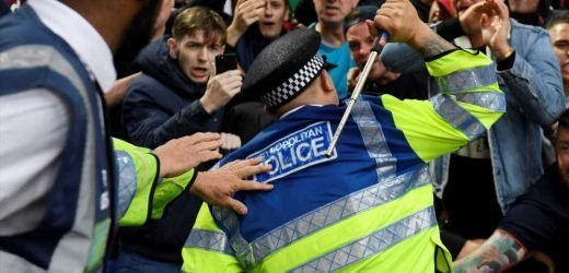 Watch Aston Villa fan be hit by baton-wielding policeman as one supporter is arrested for affray in violence at Selhurst Park – The Sun
