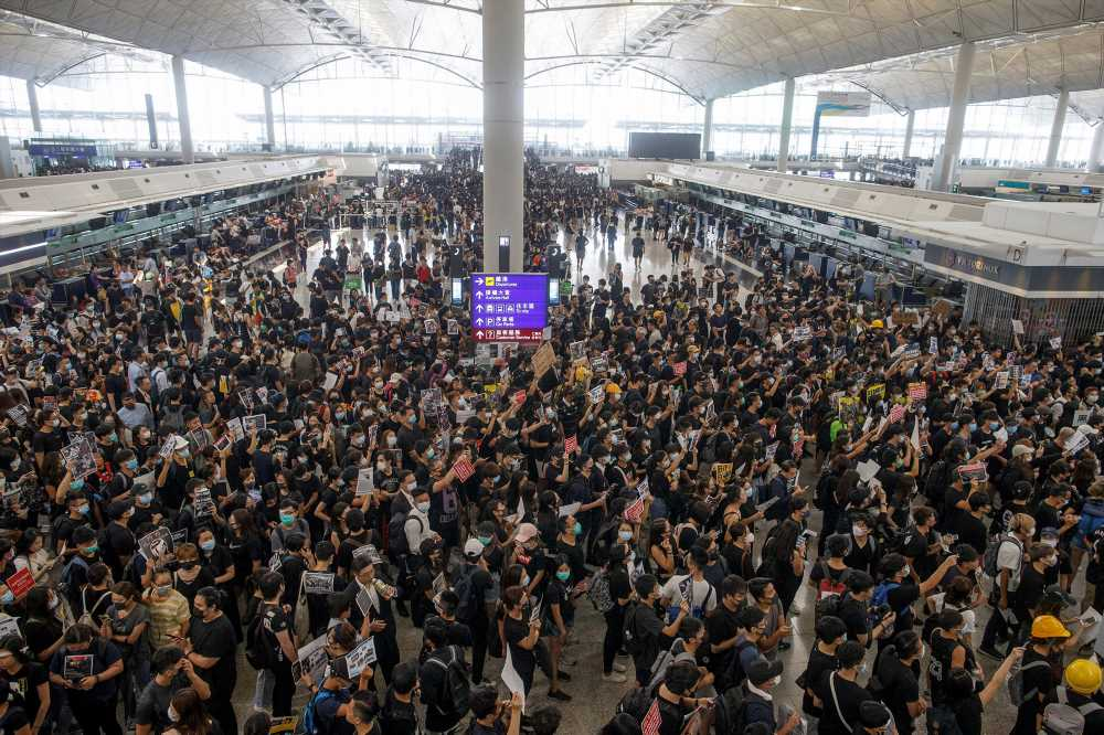 Hong Kong airport shut down after protesters storm inside