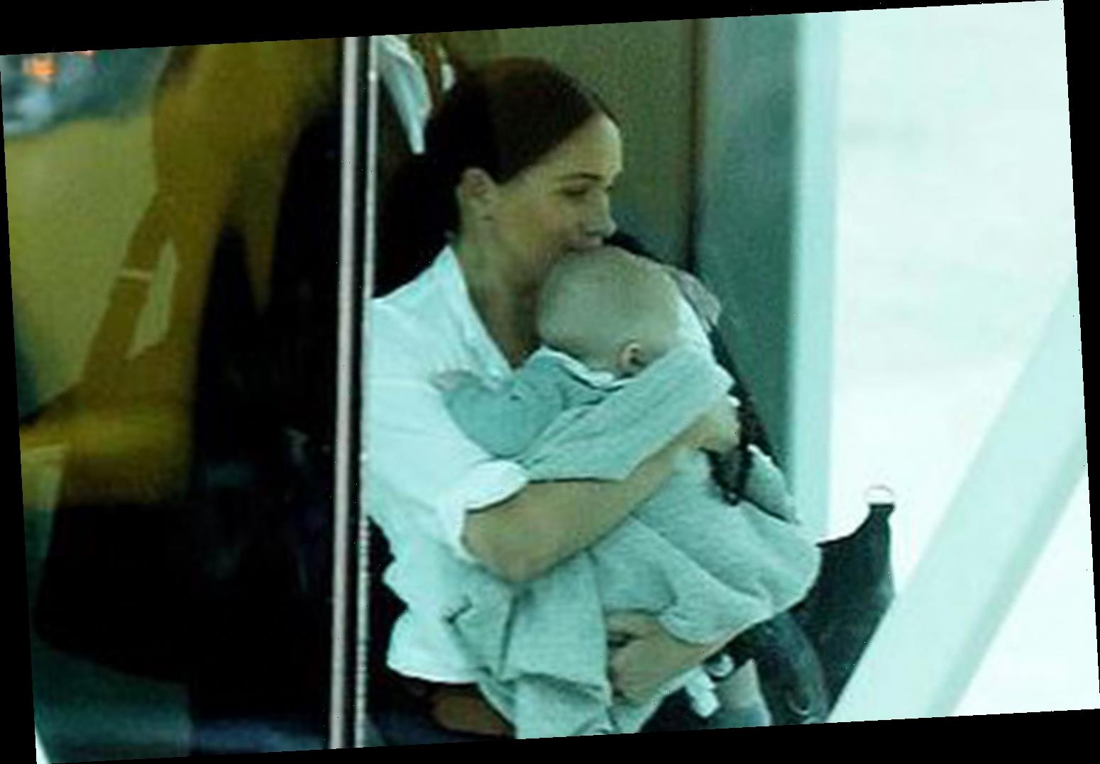 Meghan Markle clutches baby Archie as they fly BA to Johannesburg for final leg of royal tour – The Sun