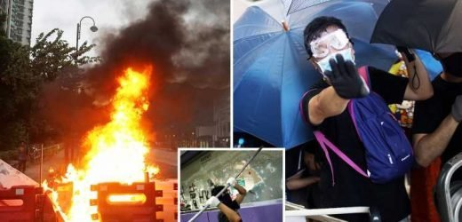 Hong Kong protests – Chaos as activists burn barriers and shutdown train to airport leaving passengers stranded
