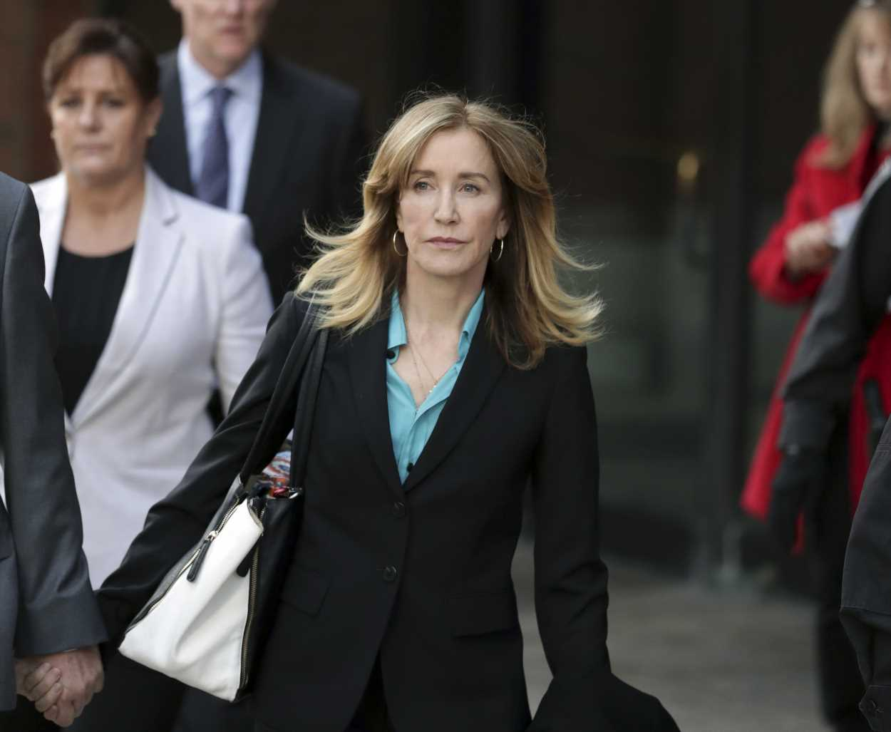 Felicity Huffman arrives in Boston for sentencing amid marital troubles: Was her husband with her?
